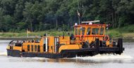 PUSHER TUG  -    VERY SHALLOW DRAFT