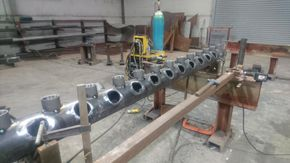 Injection head in manufacture