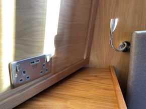 Fitted bedside cabinets and adjustable reading lights