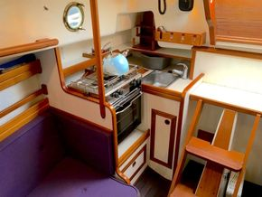 Galley with stove, cup rack, sink and cupboards