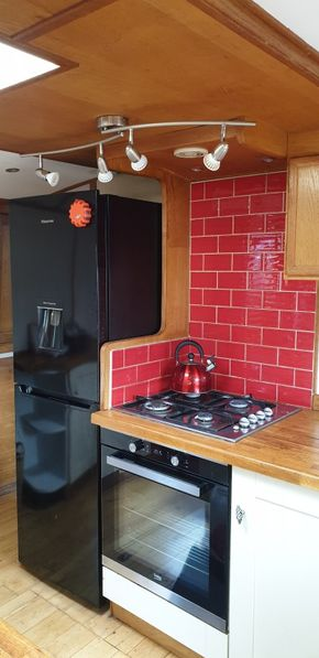 Kitchen - Fridge Freezer and oven/hob