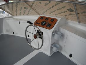 Custom built helm position.