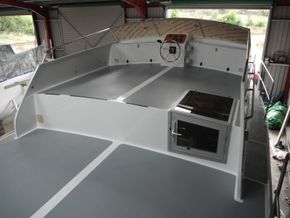 Finished flybridge with custom fitted helm