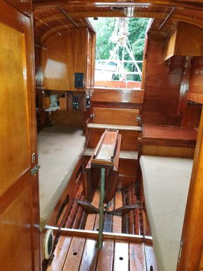 Aug 2021 main cabin cushions and folded table looking aft