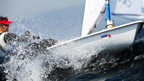 Laser Sailing in Waves
