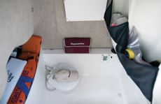 Deluxe console with portable toilet