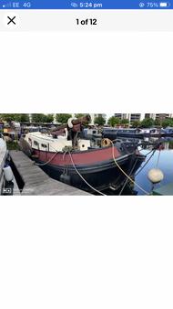 Beautiful Dutch Tjalke on residential mooring in Canary Wharf