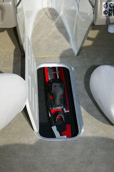Crownline Bowrider 180 BR An in-floor locker is located beneath the windshield walk-thru area between the pilot and passenger seats