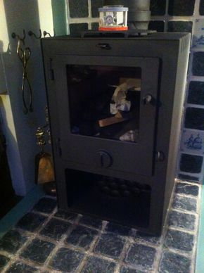 Danish multi-fuel stove cleaned and serviced annually; with detachable chimney
