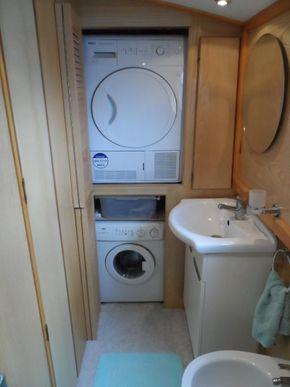 door open showing washer and dryer