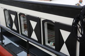 Galley windows giving good visibility with sliding shutters for shade, privacy or security at sea.