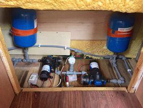 Main water pumps and accumulator tanks
