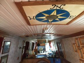 Decorative ceiling and view from front of boat to kitchen