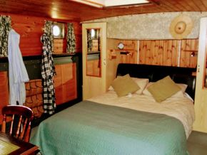 Master cabin with walk around bed