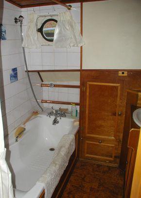 The bathroom has a 3/4 length bath