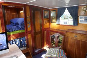 The original skipper's back cabin is traditional with a double bed at the stern