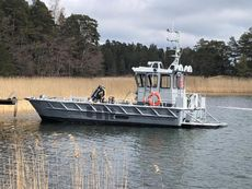 Aluminium Workboat with a back cabin.