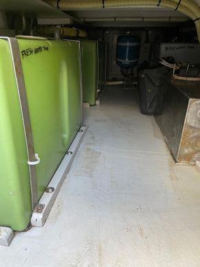 Holding tank underdeck storage