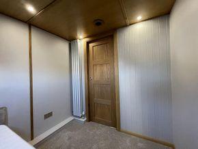 Oak doors slide inside the walls