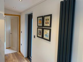 Upright modern radiators provide ample heating