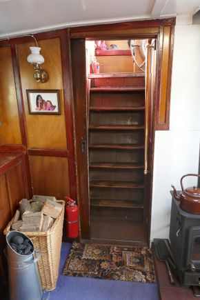 Stairs directly from the wheelhouse to the skipper's cabin