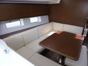 Dining table, lowerable, convertible into double berth incl. cushion, electrical