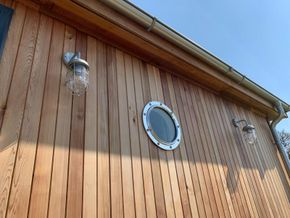 Salvaged ship portholes add to the marine look