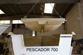 Below deck structure being lifted into place on a Pescador 700