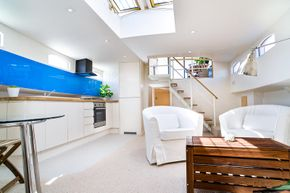 Large light open interior with stairway and skylight