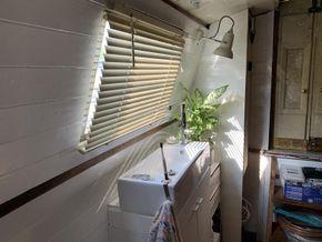 Small bathroom sink near stern door
