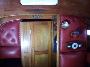 Locker door closes off twin cabin