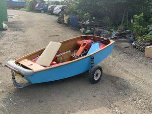 Optimist sailing dinghy