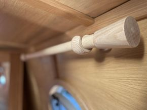 Solid wood curtain poles in master bedroom