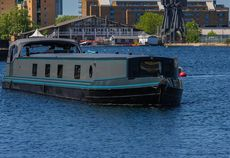 Luxury wide beam boat at Limehouse Waterside & Marina, E14