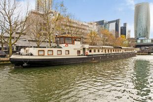 8,000 sq. ft. stunning motor barge for sale
