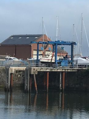 Boat being lifted out for pressure wash on 2nd July 2021