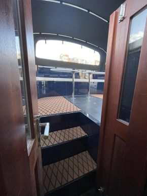 Steps leading to covered stern deck