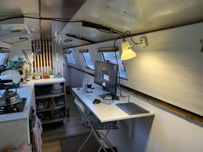 These are the fold out desks for dining + using as a desk. Worked from home for a long time during the pandemic here! The photo is a little old, and shows the old ceiling and so on.