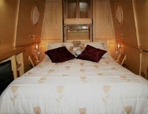Double bed with side tables and bedside reading lights