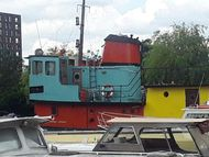 Big Tug/houseboat conversion on Residential mooring in Canary Wharf
