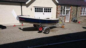 dinghy unrigged on trailer